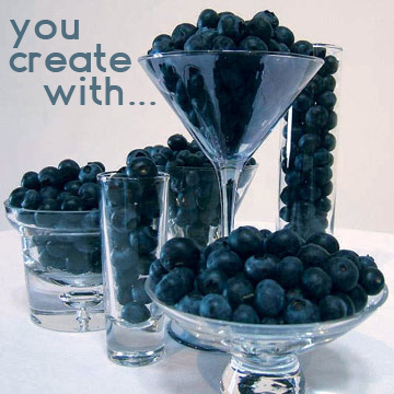 Glass vessels and blueberries, an edible blue theme.